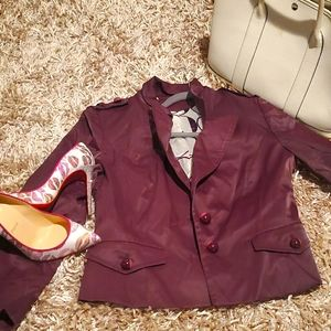 Maroon/burgundy short jacket.